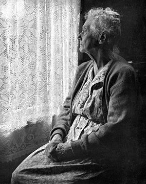 A woman looking out the window